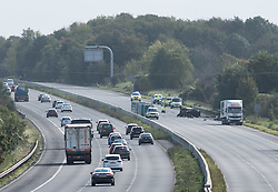 © Licensed to London News Pictures.  30/09/2017; Wiltshire, UK. Scene of crash between a lorry and a car which closed the M4 westbound in Wiltshire. Two people were injured in the incident at 05:00 BST near junction 17 at Leigh Delamere and have been taken to hospital. It is not yet known how severely they were hurt,<br /> Highways England is reporting that the M4 westbound between J17 (Chippenham) and J18 (Bath) will be closed until at least 4.30pm. A separate accident at junction 15 near Marlborough has also closed two lanes and diversions are in place. Picture credit : Simon Chapman/LNP