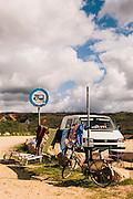 Camper vans with surf gear at Amado beach, Western Algarve