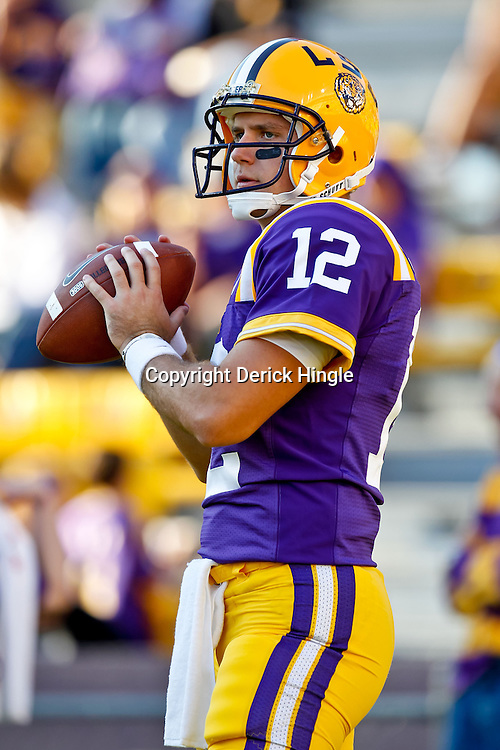 October 16, 2010; Baton Rouge, LA, USA; LSU Tigers quarterback Jarrett Lee (12) during warm ups prior to kickoff against the McNeese State Cowboys at Tiger Stadium. LSU defeated McNeese State 32-10. Mandatory Credit: Derick E. Hingle