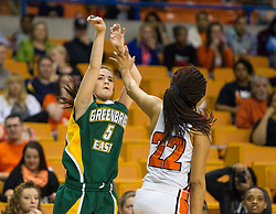 Greenbrier East forward Katelyn Wilmer (5) shoots a three pointer over South Charleston center Rhea Smith (22) during a first round game at the Charleston Civic Center.
