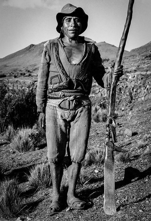 "Quechua peasant farming with the use of this ""chaquitajlla"" –an upright plouh used since pre-Colombian times. Willoq, Peru."