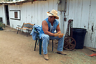 Lifestyle portrait of rancher resting outside in San Diego, CA.