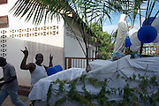 Catholic Creoles dress vehicles with Mary during celebrations at religious festival on streets in colonial quarter of Kourou in French Guiana
