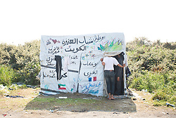 © Licensed to London News Pictures. 30/08/2015. Calais, France. A tent with arabic writing at the refugee camp in Calais, also known as the Jungle. Tomorrow the French PM, Manuel Valls, will visit the day centre Jules Ferry at the camp. Photo credit : Isabel Infantes/LNP