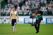 Legia's Jakub Kosecki and TV cameraman after the UEFA Champions League play-off second leg match between Legia Warsaw and FC Steaua Bucuresti at Pepsi Arena Stadium in Warsaw on August 27, 2013.<br /> <br /> Poland, Warsaw, August 27, 2013<br /> <br /> Picture also available in RAW (NEF) or TIFF format on special request.<br /> <br /> For editorial use only. Any commercial or promotional use requires permission.<br /> <br /> Photo by &copy; Adam Nurkiewicz / Mediasport