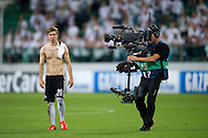 Legia's Jakub Kosecki and TV cameraman after the UEFA Champions League play-off second leg match between Legia Warsaw and FC Steaua Bucuresti at Pepsi Arena Stadium in Warsaw on August 27, 2013.<br /> <br /> Poland, Warsaw, August 27, 2013<br /> <br /> Picture also available in RAW (NEF) or TIFF format on special request.<br /> <br /> For editorial use only. Any commercial or promotional use requires permission.<br /> <br /> Photo by © Adam Nurkiewicz / Mediasport