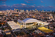 Aerial of the Miami Marlins baseball stadium park glows with downtown Miami in the background suitable for a framed poster print.