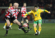 Doncaster - Friday January 30th 2009:Wes Hoolahan of Norwich City & James O'Connor of Doncaster Rovers in action during the Coca Cola Championship Match at The Keepmoat Stadium Doncaster. (Pic by Steven Price/Focus Images)