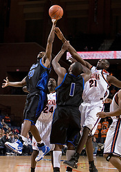 Longwood Lancers forward Lamar Barrett (50) blocks the shot of Virginia Cavaliers center Tunji Soroye (21).  The Virginia Cavaliers Men's Basketball Team defeated Longwood University 90-49 at the John Paul Jones Arena in Charlottesville, VA on February 13, 2007.