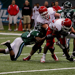 Oct 17, 2009; New Orleans, LA, USA;  Houston Cougars safety Jeremy Smith (25) runs through a tackle attempt by Tulane Green Wave safety Chinonso Echebelem (24) to score a touchdown in the second half at the Louisiana Superdome. Houston defeated Tulane 44-16. Mandatory Credit: Derick E. Hingle-US PRESSWIRE