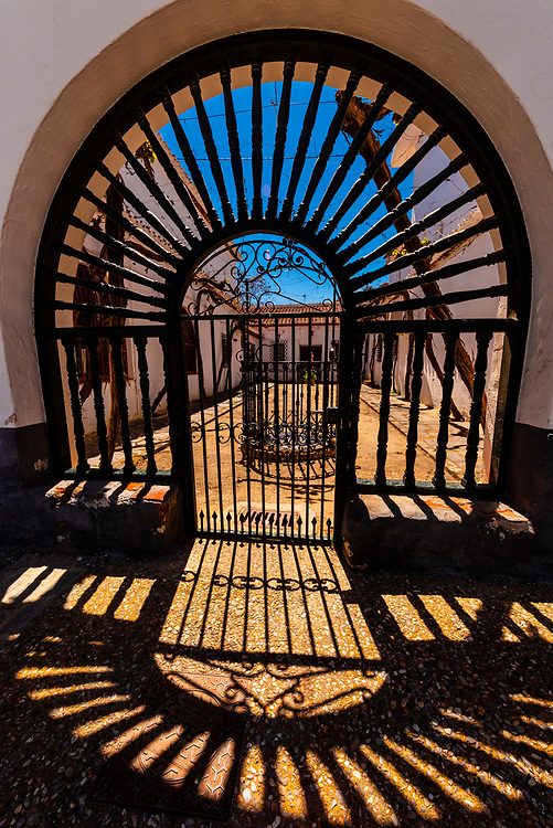 Shadows of a gate,  Barrio de Cuevas section of Guadix, Granada Province, Andalusia, Spain.
