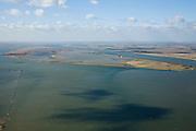 Nederland, Zuid-Holland, Tiengemeten, 04-03-2008; eilandje in het Haringvliet, oorspronkelijk eigendom - binnen de dijken - van AMEV (Fortis Investments) en Natuurmonumenten (buitendijkse slikken); het eiland werd gebruikt voor de akkerbouw maar is inmiddels 'teruggegeven aan de natuur' (dijken deels doorgestoken) , de laatste boer is in 2006 vertrokken; huidig gebruik onder andere zorgboerderij en kan er gekampeerd worden; nieuwe natuur, onderdeel van de Ecologische Hoofdstructuur; natuurontwikkelingsgebied, natuurontwikkeling natuurontwikkeling; tiengemeenten, schorren. .luchtfoto (toeslag); aerial photo (additional fee required); .foto Siebe Swart / photo Siebe Swart