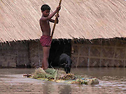 Muhammed Rahimuddin, a village boy carries his goat to a safer place by raft, when his goat-shed inundates by floodwaters at Sialmari village, about 329 kilometers southwest of Gauhati, the capital city of Northeastern Indian state, Assam, Monday, June 28, 2004. ..Floodwaters of the Asia'a one of the largest river, Brahmaputra and its 35 tributaries have affected more than one million in all of Indian subcontinent and disrupted communication in many parts of the India and Bangladesh, sources said.  (AP Photo/ Shib Shankar Chatterjee)..
