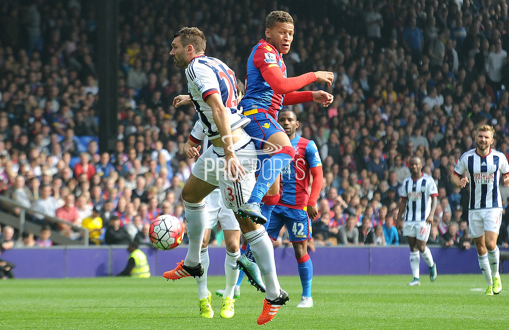 Dwight Gayle winning the ariel battle during the Barclays Premier League match between Crystal Palace and West Bromwich Albion at Selhurst Park, London, England on 3 October 2015. Photo by Michael Hulf.