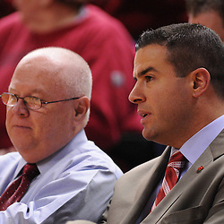 Mar 2, 2009; Piscataway, NJ, USA; Rutgers' new athletic director Tim Pernetti (right) takes in the second half of Rutgers game against nationally rated #1 Connecticut at the Louis Brown Athletic Center.  Connecticut won 69-59 to finish their regular season a perfect 30-0.