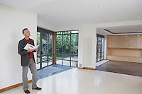 Real estate agent observing new property