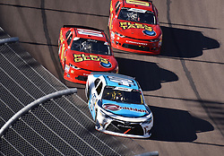 November 10, 2018 - Phoenix, Arizona, U.S. - PHOENIX, AZ - NOVEMBER 10:  Chad Finchum (40) Chevrolet, BJ McLeod  (01) Chevrolet and Garrett Smithley (0) Chevrole on the track tat the NASCAR Xfinity Series Playoff Race - Whelen 200  on November 10, 2018 at ISM Raceway in Phoenix, AZ.  (Photo by Lyle Setter/Icon Sportswire) (Credit Image: © Lyle Setter/Icon SMI via ZUMA Press)