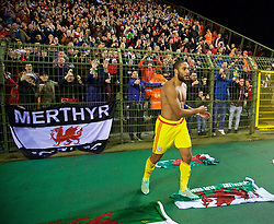BRUSSELS, BELGIUM - Sunday, November 16, 2014: Wales' captain Ashley Williams after throwing his shirt into the supporters following a goal-less draw with Belgium during the UEFA Euro 2016 Qualifying Group B game at the King Baudouin [Heysel] Stadium. (Pic by David Rawcliffe/Propaganda)