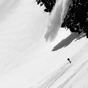 Ryan Dee skis past his sluff at the bottom of the East Face of No Name peak in the Teton backcountry.