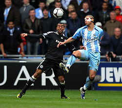 Ashley Cole of Chelsea and Leon Best of Coventry in action  during the FA Cup Sponsored by E.ON 6th round match between Coventry City and Chelsea at the Ricoh Arena on March 7, 2009 in Coventry, England.