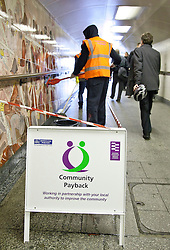 © under license to London News Pictures. 05/04/11. Pedestrians pass an offender cleaning Hyde Park Corner underpass ahead of the Royal Wedding in April. The offenders were taking part in a Community Payback scheme managed by the London Probation Trust in anticipation of thousands of people using subways to get around London during the wedding weekend. Credit should read Matt Cetti-Roberts/LNP