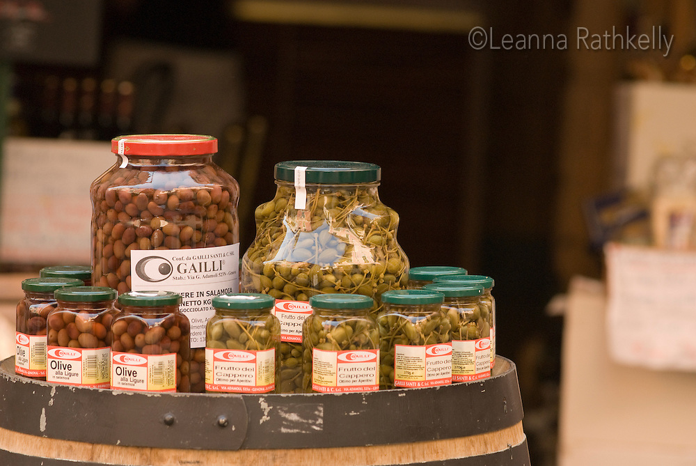 Olives are displayed in jars in the town of Monterosso, Cinque Terre region, Italy.