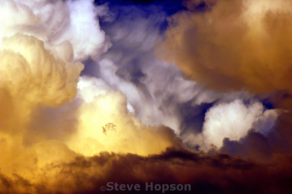 Breaking a long summer Texas drought, these golden clouds demonstrate the power and beauty of natural forces, June 22, 2005.