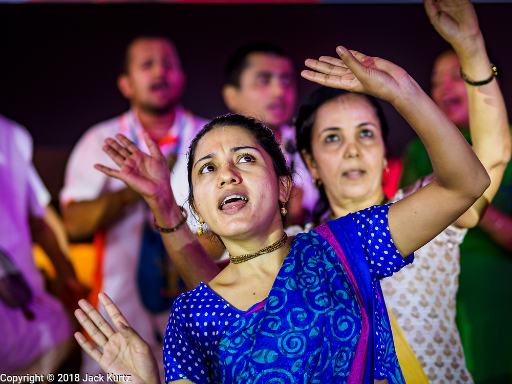 "23 SEPTEMBER 2018 - BANGKOK, THAILAND:  Women dance during the Ganesha Festival at Wat Dan in Bangkok. Ganesha Chaturthi also known as Vinayaka Chaturthi, is the Hindu festival celebrated on the day of the re-birth of Lord Ganesha, the son of Shiva and Parvati. The festival, also known as Ganeshotsav (""festival of Ganesha"") is observed in the Hindu calendar month of Bhaadrapada, starting on the the fourth day of the waxing moon. The festival lasts for 10 days, ending on the fourteenth day of the waxing moon. Outside India, it is celebrated widely in Nepal and by Hindus in the United States, Canada, Mauritius, Singapore, Thailand, Cambodia, and Burma.   PHOTO BY JACK KURTZ"