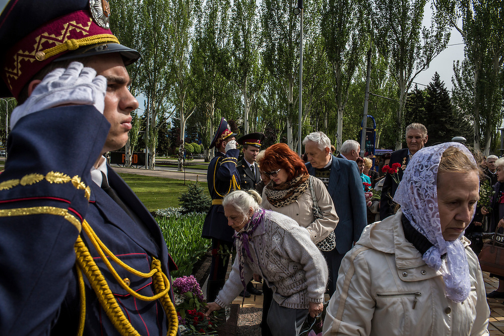 DONETSK, UKRAINE - MAY 9: People lay flowers at a memorial for victims of World War II on the Victory Day holiday on May 9, 2014 in Donetsk, Ukraine. Tensions in Eastern Ukraine are high after pro-Russian activists seized control of at least ten cities and ahead of the Victory Day holiday and a planned referendum on greater autonomy for the region. (Photo by Brendan Hoffman/Getty Images) *** Local Caption ***