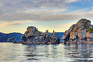 A grab shot of some islands and rocks in the Broken Islands at sunset. HDR image.  Great Barrier Island.