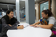 Sabrina Villanueva speaks with her friend Magdalena Granados in the library at the University of Rochester in Rochester, New York on August 31, 2016. Villanueva earned 12 credits through a community college while in high school in Dallas, but the University didn't accept them, causing her to pursue a minor in Spanish rather than sociology or psychology as she had originally intended.