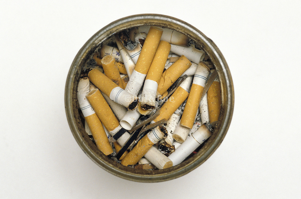 cigarette butts in glass jar seen from above