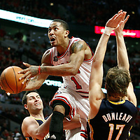 16 April 2011:  Chicago Bulls point guard Derrick Rose (1) goes for the layup past Indiana Pacers small forward Mike Dunleavy (17) during the Chicago Bulls 104-99 victory over the Indiana Pacers, during the game 1 of the Eastern Conference first round at the United Center, Chicago, Illinois, USA.