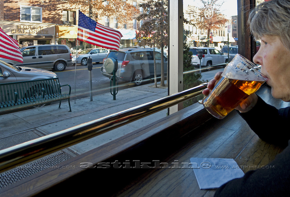 Woman sitting in a bar drinking beer