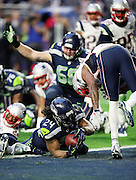 Seattle Seahawks running back Marshawn Lynch (24) scores a second quarter touchdown that ties the score at 7-7 during the NFL Super Bowl XLIX football game against the New England Patriots on Sunday, Feb. 1, 2015 in Glendale, Ariz. The Patriots won the game 28-24. ©Paul Anthony Spinelli