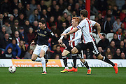 Barnsley midfielder Adam Hammill (7) chased down by Brentford midfielder Ryan Woods (15) and Brentford defender Andreas Bjelland (5) during the EFL Sky Bet Championship match between Brentford and Barnsley at Griffin Park, London, England on 22 October 2016. Photo by Martin Cole.