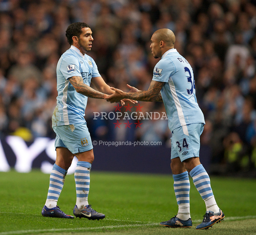 MANCHESTER, ENGLAND - Monday, April 30, 2012: Manchester City's Carlos Tevez is substituted for Nigel de Jong against Manchester United during the Premiership match at the City of Manchester Stadium. (Pic by David Rawcliffe/Propaganda)