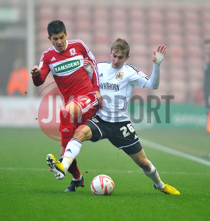 Bristol City's Joe Bryan battles for the ball with Middlesbrough's Emmanuel Ledesma - Photo mandatory by-line: Joe Meredith/JMP  - Tel: Mobile:07966 386802 24/11/2012 - Middlesbrough v Bristol City - SPORT - FOOTBALL - Championship -  Middlesbrough  - River Side Stadium