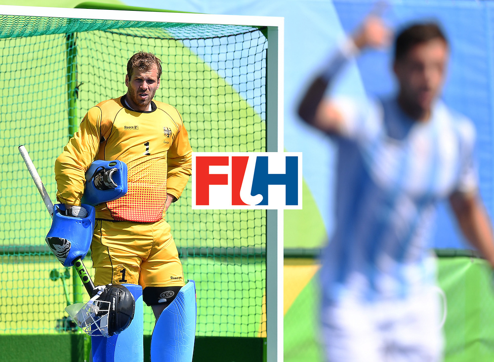 Germany's Nicolas Jacobi looks from the goal after Argentina's fourth goal during the men's semifinal field hockey Argentina vs Germany match of the Rio 2016 Olympics Games at the Olympic Hockey Centre in Rio de Janeiro on August 16, 2016. / AFP / MANAN VATSYAYANA        (Photo credit should read MANAN VATSYAYANA/AFP/Getty Images)