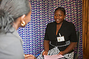 A HIV counsellor talks to a patient at the Voluntary Counselling and Testing clinic for HIV and TB at the Bwindi Community Hospital.  The hospital is in Buhoma village on the edge of the Bwindi Impenetrable Forest in Western Uganda. It serves around 250 000 people from the surrounding area.