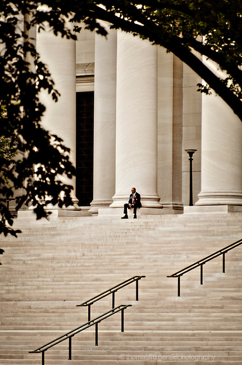 A Security Guard Sits in front of the enterance to the Smithsonian Museum