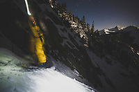 Maxwell J Morrill ascends Tanner's Couloir by headlamp before dawn, Wasatch Mountains, Utah.