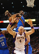 Feb. 4, 2011; Phoenix, AZ, USA; Phoenix Suns forward Marcin Gortat (4) reacts after being fouled by Oklahoma City Thunder forward Serge Ibaka (9) at the US Airways Center. The Thunder defeated the Suns 111-107. Mandatory Credit: Jennifer Stewart-US PRESSWIRE