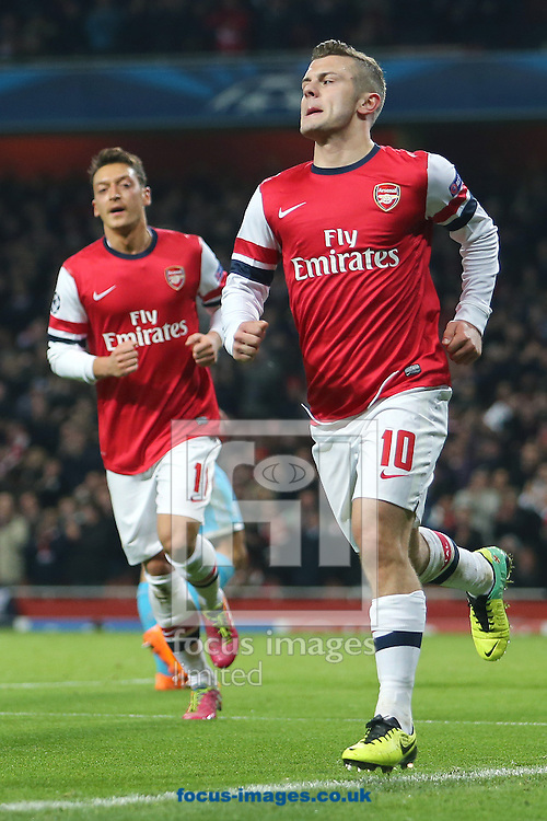 Picture by Richard Calver/Focus Images Ltd +447792 981244<br /> 26/11/2013<br /> Jack Wilshere of Arsenal (right) celebrates his and sides second goal against Olympique de Marseille during the UEFA Champions League match at the Emirates Stadium, London.