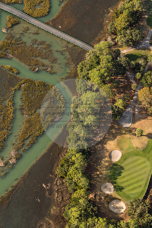 Aerial view of a golf course and marsh in Charleston, SC.