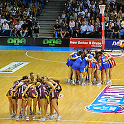 The teams huddle prior to the centre pass start - Netball action from ANZ Championship Grand Final - Queensland Firebirds v Northern Mystics - played at the Brisbane Convention Centre on Sunday 22nd May 2011 ~ Photo : Steven Hight (AURA Images) / Photosport