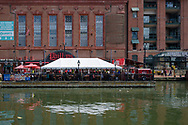 Baltimore, MD, USA --April 13, 2019-- Patrons dine outdoors under a tent on the promenade of Baltimore's inner harbor.