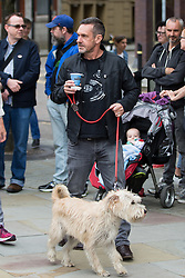 © Licensed to London News Pictures . 14/08/2016 . Manchester , UK . PAUL MASON arrives with a dog . A memorial on the site of The Peterloo Massacre ( formerly St Peter's Field , now the Manchester Central Convention Centre ) , attended by Maxine Peake and Paul Mason . On 16th August 1819 , a rally calling for Parliamentary reform , improved workers rights and against poverty was brutally suppressed by sabre-wielding cavalrymen , resulting in the deaths of fifteen people and many hundreds injured . Photo credit : Joel Goodman/LNP