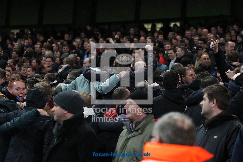 Picture by Paul Chesterton/Focus Images Ltd +44 7904 640267<br /> 08/01/2014<br /> The West Ham fans do the &quot;Poznan&quot; during the Capital One Cup Semi Final 1st Leg match at the Etihad Stadium, Manchester.