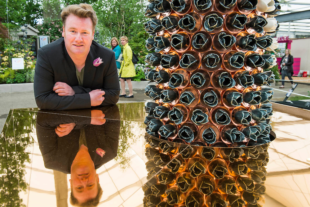 Paul Cummins MBE with his tower of ceramic tulips, Candy - unveiled for teh first time and also for charity. RHS Chelsea Flower Show, Chelsea Hospital, London UK, 18 May 2015.